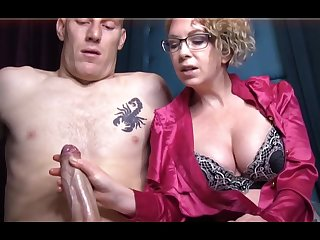 Domme T is a horny, platinum-blonde female in a satin tee-shirt who enjoys to give lecherous handjobs