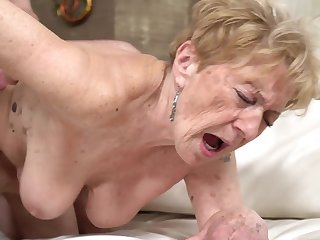 A nasty old granny is acquiring fucked with regard to her pussy doggy style