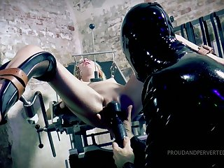 Suspended upside down bitch Odette Delacroix gives a blowjob roughly one lady's man in latex outfit