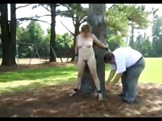 My slave publicly punished in a park.