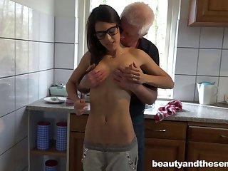 Skinny slut Carolina upon glasses having sex upon an old guy