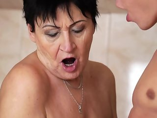 Saleable granny enjoys wettish voiced session with a younger guy