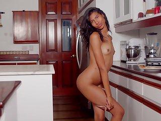 Hot ass Latina Scarlett Camila masturbates in be passed on kitchen