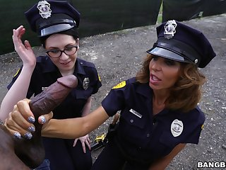 Glum female cops share black meat on the street